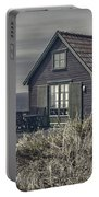 Seaside Cottage At Dusk Portable Battery Charger