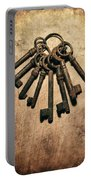 Set Of Old Rusty Keys On The Metal Surface Portable Battery Charger