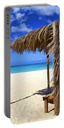 Shelter On A White Sandy Caribbean Beach With A Blue Sky And White Clouds Portable Battery Charger