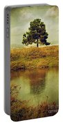 Single Pine Tree Portable Battery Charger by Carlos Caetano