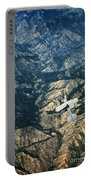 Small Plane Flying Over Mountains Portable Battery Charger