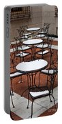 Snow Covered Patio Chairs And Tables Portable Battery Charger