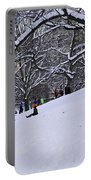 Snow Day In The Park Portable Battery Charger by Madeline Ellis