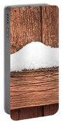 Snow On Fence Portable Battery Charger by Tom Gowanlock