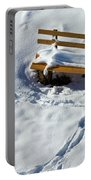Snowy Foot Prints Around Snow Covered Park Bench Portable Battery Charger