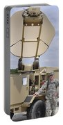 Soldier Stands Next To A Satellite Portable Battery Charger