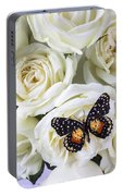 Speckled Butterfly On White Rose Portable Battery Charger