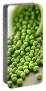 Spilled Bowl Of Green Peas Portable Battery Charger