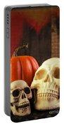 Spooky Halloween Skulls Portable Battery Charger by Edward Fielding