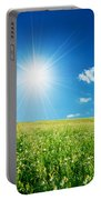 Spring Field With Flowers And Blue Sky Portable Battery Charger