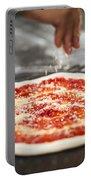 Sprinkling Cheese On Home Made Pizza Portable Battery Charger