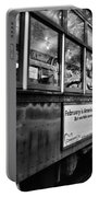 St. Charles Ave Streetcar Whizzes By-black And White Portable Battery Charger
