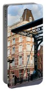 Staalstraat Bridge On Kloveniersburgwal Canal In Amsterdam Portable Battery Charger