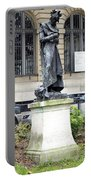 Statue In A Paris Park Portable Battery Charger