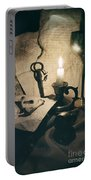 Still Life With Bones Rusty Key Wine Glass Lit Candle And Papers Portable Battery Charger