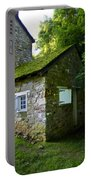 Stone House With Mossy Roof Portable Battery Charger