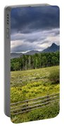 Storm Clouds Over The Rockies Portable Battery Charger