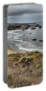 Storms Over An Unspoiled Beach Portable Battery Charger by Adam Jewell