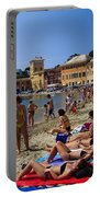 Sun Bathers In Sestri Levante In The Italian Riviera In Liguria Italy Portable Battery Charger