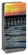 Sun Over Pier And Bird In Surf Portable Battery Charger
