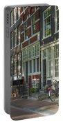 Sunny Street In Amsterdam Portable Battery Charger