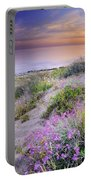Sunset At The Beach  Flowers On The Sand Portable Battery Charger
