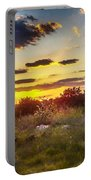Sunset Over Field Of  Flowers Portable Battery Charger