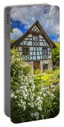Swiss Chalet In The Garden Portable Battery Charger by Debra and Dave Vanderlaan