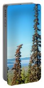 Tall Pine Trees And Hilly Background Portable Battery Charger