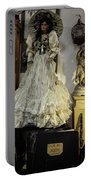 The Antique Doll Portable Battery Charger