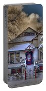 The Decorated Little House In The Snow Portable Battery Charger