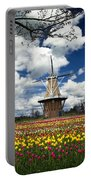 The Dezwaan Dutch Windmill Among The Tulips On Windmill Island In Holland Michigan Portable Battery Charger