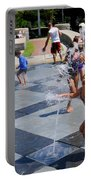 Joyful Young Girl Playing In Fountain Portable Battery Charger