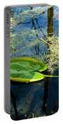 The Floating Leaf Of A Water Lily Portable Battery Charger