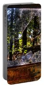 The Woods Through A School Bus Window Portable Battery Charger