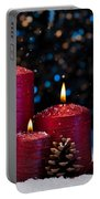 Three Red Candles In Snow  Portable Battery Charger