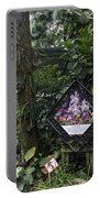 Tourist Doing Photography And Viewing Plants In A Garden Portable Battery Charger