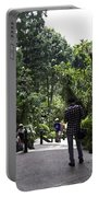 Tourists Inside A Downward Sloping Section In The Orchid Garden Portable Battery Charger