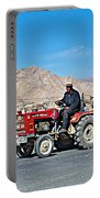 Tractor Towing A Wagon Along The Road To Shigatse-tibet Portable Battery Charger