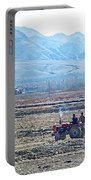 Tractor Used In Farming Along The Road To Shigatse-tibet Portable Battery Charger