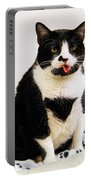 Tuxedo Cat Sticking Out Her Tongue Portable Battery Charger by Catherine Sherman