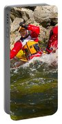 Two Men Paddling A Red Whitewater Canoe Portable Battery Charger