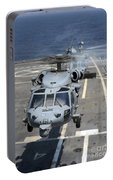 Two Mh-60s Sea Hawk Helicopters Take Portable Battery Charger
