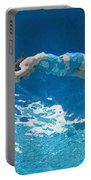 Underwater View Of Woman Diving Into Portable Battery Charger