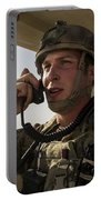 U.s. Air Force Soldier Communicates Portable Battery Charger