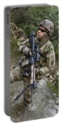 U.s. Army Soldier Walks Through A Creek Portable Battery Charger