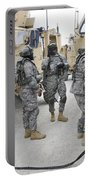 U.s. Army Soldiers Jump Start A Light Portable Battery Charger