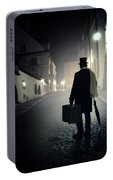 Victorian Man With Top Hat Carrying A Suitcase Walking In The Old Town At Night Portable Battery Charger