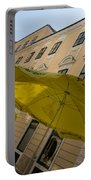 Vienna Street Life - Cheery Yellow Umbrellas At An Outdoor Cafe Portable Battery Charger