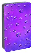 Water Drops On Purple And Blue Portable Battery Charger